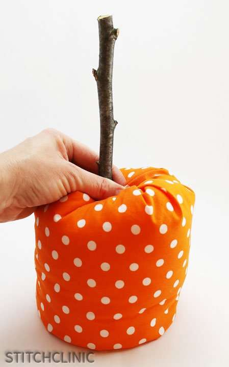 fabric pumpkin with a stick for a stem