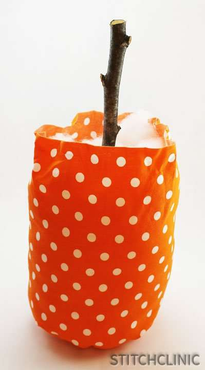 Pumpkin with stem inserted and ready to be sewn