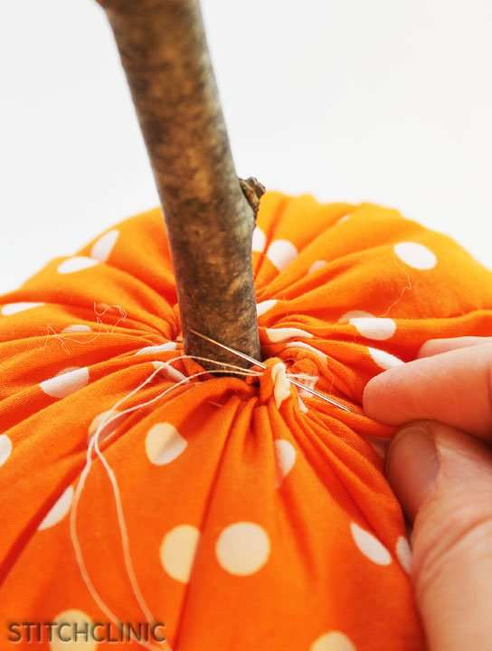 Securing the top of the pumpkin around the stem