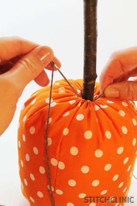 Bringing the yarn to the top of the pumpkin to make another section.