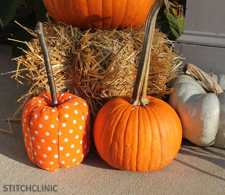 Fabric and Real Pumpkin sitting on a porch