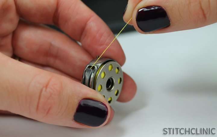 loading bobbin thread into bobbin case