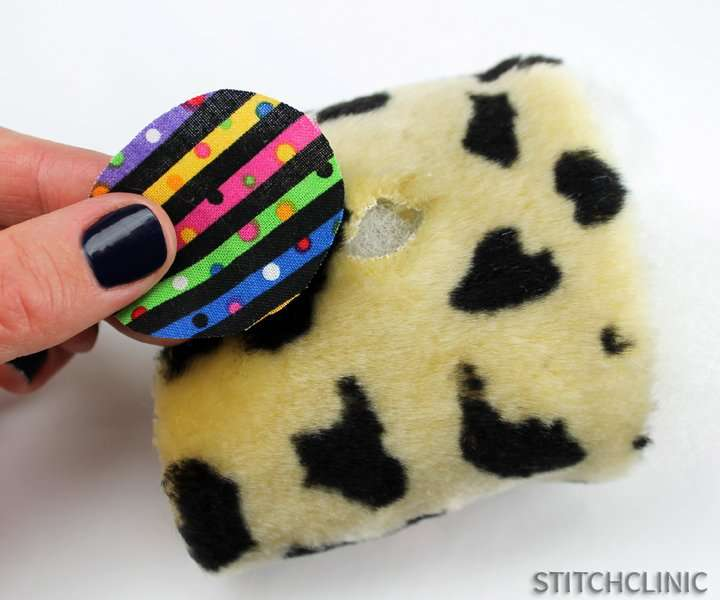 Placing fabric/patch over hole on stufffed animal